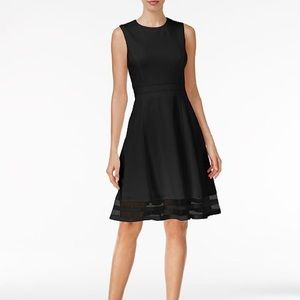 Black fit and flare illusion dress